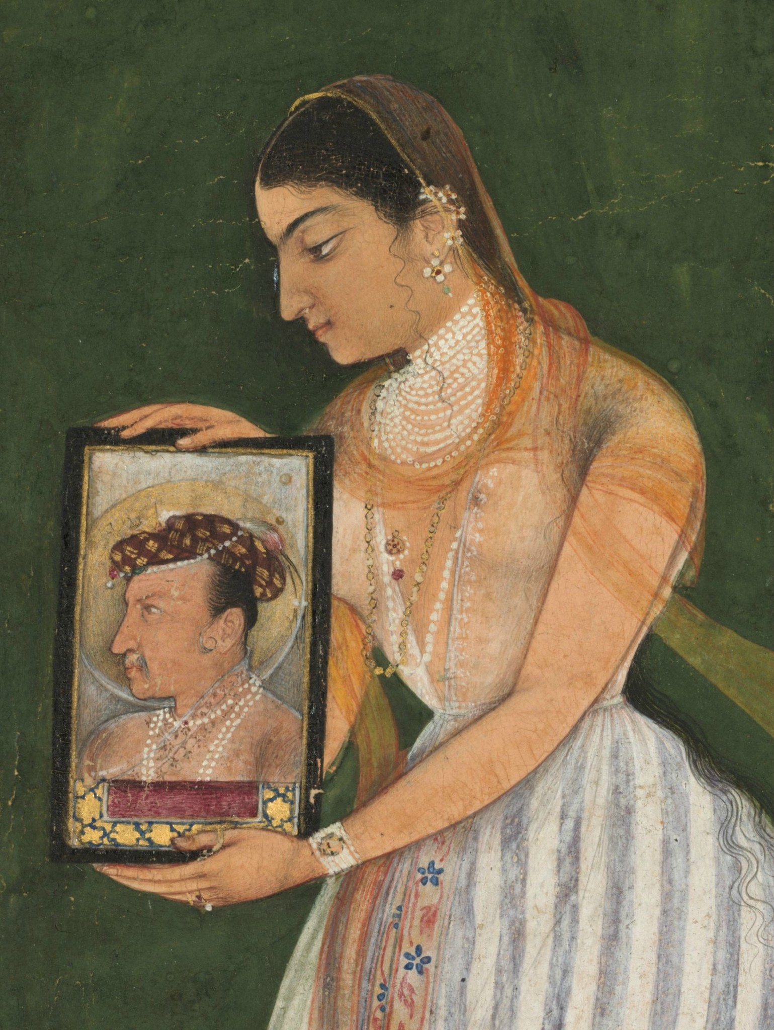 Nur_Jahan_holding_a_portrait_of_Emperor_Jahangir,_about_1627.jpg