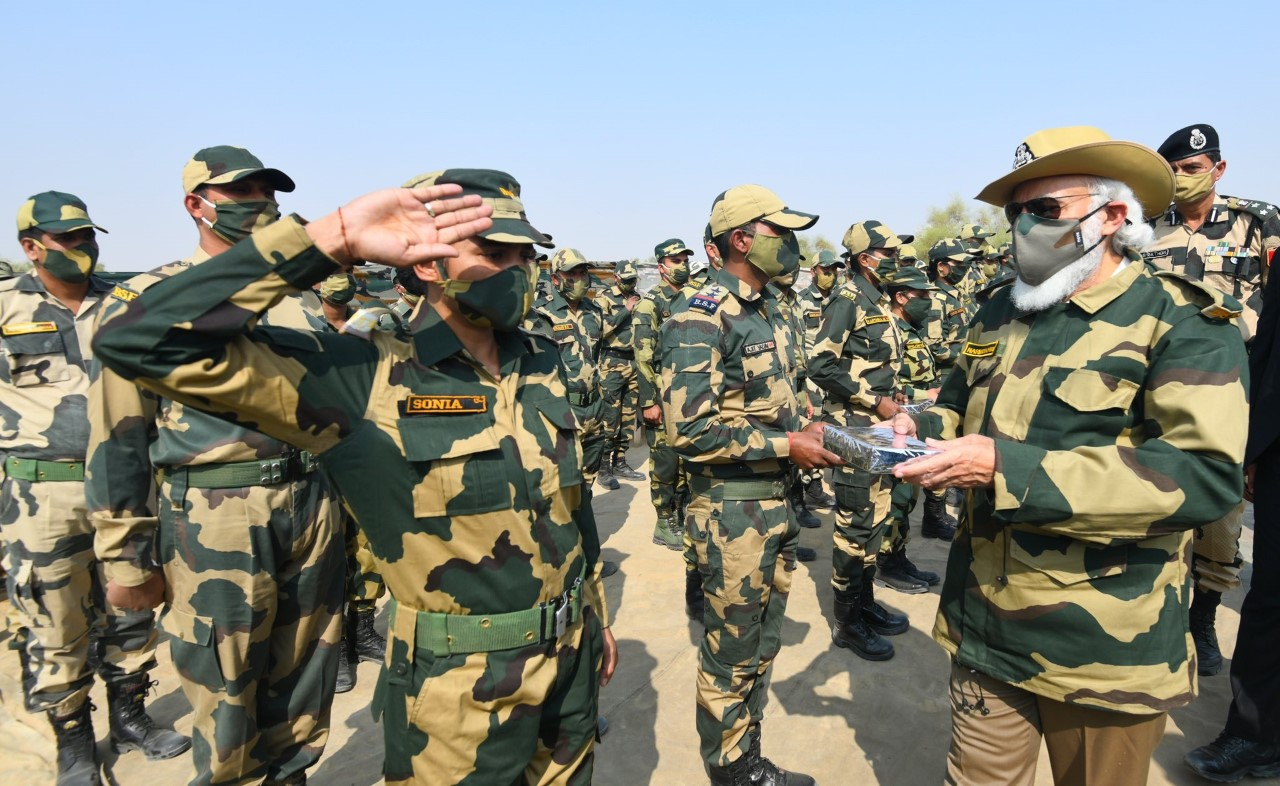 thumbnail_Courtesy Narendra Modi Twitter 3, distributing sweets among army men.jpg